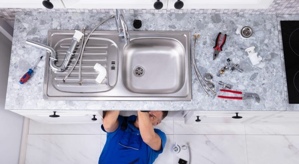 Plumb a Kitchen Sink With Disposal and Dishwasher 4